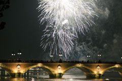 Silver fireworks over bridge Royalty Free Stock Images