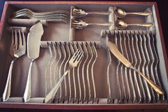 Silver fish tableware in drawer. Beautiful vintage silver fish cutlery set for 12 people completed with server flatware Royalty Free Stock Image