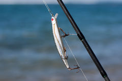 Silver fishing lure in fishing rod Stock Image