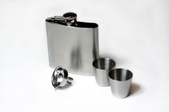 Silver Flask and Shot Glasses Stock Images