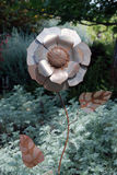 Silver Flower. Metal flower sculpture in the gardens of a winery in Amador County, Northern California Royalty Free Stock Image