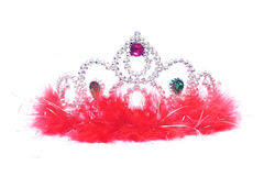 Silver fluffy crown with red jewels on white backg Royalty Free Stock Photo