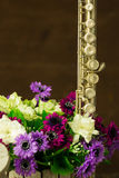 Silver flute and flower Royalty Free Stock Image