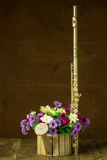 Silver flute and flower Royalty Free Stock Photography