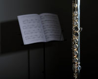 Silver Flute with sheet music Stock Image