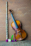 Silver flute and violin Royalty Free Stock Photos