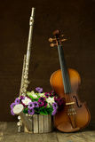 Silver flute and violin Stock Image