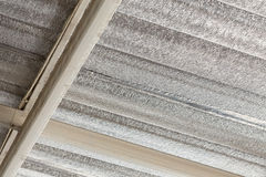 Silver foil insulation on ceiling roof Stock Photos
