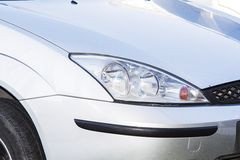Silver ford focus headlight Royalty Free Stock Photos