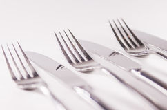 Silver fork and kniefs isolated on white background Royalty Free Stock Photos