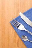 Silver fork and knife as utensils at napkin Royalty Free Stock Photo