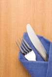 Silver fork and knife as utensils in napkin Stock Photo