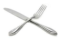 Silver Fork and Knife Cross royalty free stock photography