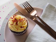 Silver Fork and Knife on Round Plate With Cupcake royalty free stock photos