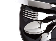 Silver fork, knife and spoon as utensils Stock Images