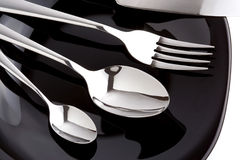 Silver fork, knife and spoon as utensils on plate Royalty Free Stock Photo