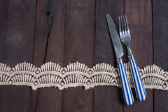 Silver fork,and knife tied and chintz and lace ribbon with copy Royalty Free Stock Photography