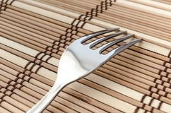 Silver fork on a napkin Stock Photo