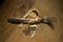 Silver fork tied in ribbon Stock Photos