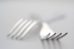 Silver forks. Close-up of a two silver forks with very limited depth of field stock photo