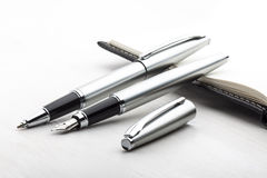 Silver fountain pen and roller pen Royalty Free Stock Photography