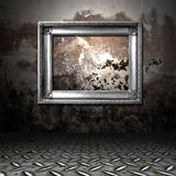 Silver frame. In a dark grungy room Royalty Free Stock Photography