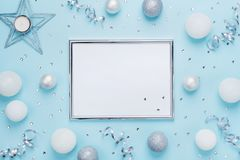 Silver Frame And Christmas Decoration On Stylish Blue Table Top View. Fashion Background. Flat Lay. Party Mockup, Invitation.
