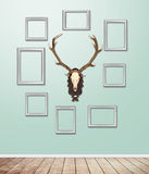 Silver Frame decor with antler hang on wallpaper with light flare. stock photo
