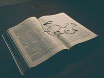 Silver Frame Eyeglasses in a Black and White Book Royalty Free Stock Photos
