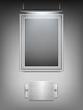 Silver frame hanging on the wall Stock Image