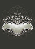 Silver frame with heraldry and pattern of spirals on dark background Royalty Free Stock Photography