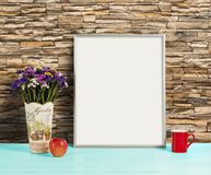 Silver frame mockup with field flowers in vase, apple and mug Stock Image