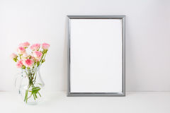 Silver frame mockup with pink roses Stock Image