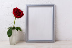 Silver frame mockup with red rose in glass vase Royalty Free Stock Photos