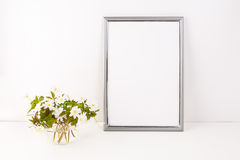 Silver frame mockup with Rue Anemone flowers stock photography