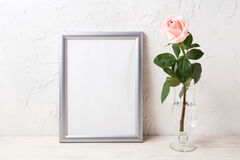 Silver frame mockup with soft pink rose in exquisite vase Royalty Free Stock Image