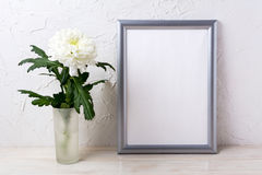 Silver frame mockup with white chrysanthemum in glass vase Stock Image