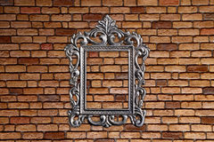Silver frame on old brick wall. Background Royalty Free Stock Photos