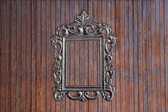 Silver frame on old wooden wall Stock Photography