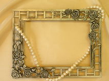 Silver frame and pearls royalty free stock photo