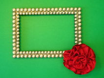 Silver frame and red ribbon Royalty Free Stock Photography