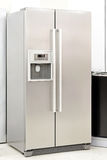 Silver fridge. With double doors an ice maker Royalty Free Stock Image