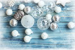 Silver Frosted Christmas balls ornaments and decorations on wood. En background , top view Stock Image