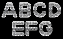 Silver A-G letters incrusted with diamonds Royalty Free Stock Photography