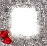 Silver garland frame and red Christmas baubles Royalty Free Stock Photos
