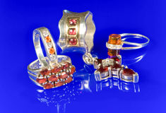 Silver and garnet. Silver jewelry and garnet stones Stock Image