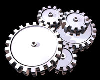 Silver gears. Illustration of highly polished interlocking cogs and gears Stock Image