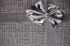 Silver gift as background. Silver gift with a bow as background Stock Photography