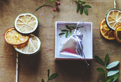Silver gift bag and citrus slices on canes Royalty Free Stock Photos