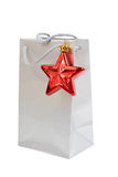 Silver gift bag with a red star isolated Stock Photo